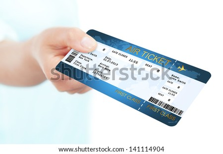 blue fly air ticket holded by hand over white background - stock photo