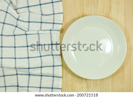 blue folded tablecloth and plate - stock photo