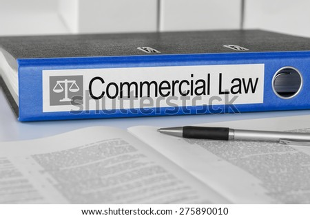 Blue folder with the label Commercial Law