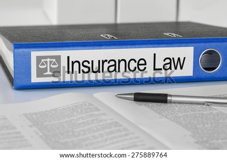 Blue folder with the label Insurance Law - stock photo