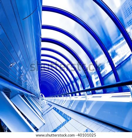 blue futuristic corridor in airport - stock photo