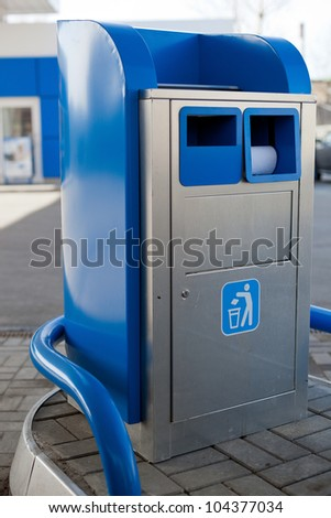 Blue garbage can on gas station - stock photo