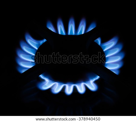 blue gas flame isolated on black - stock photo