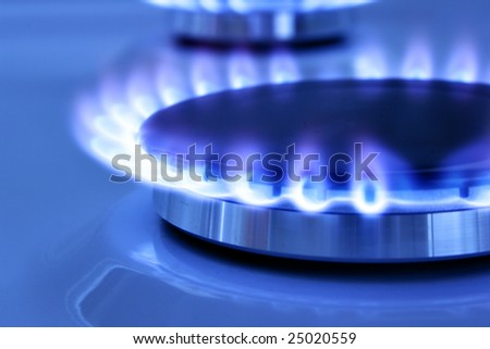Blue gas flame on the hob close up - stock photo