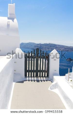 blue gates against volcano caldera, beautiful details of Santorini island, Greece - stock photo