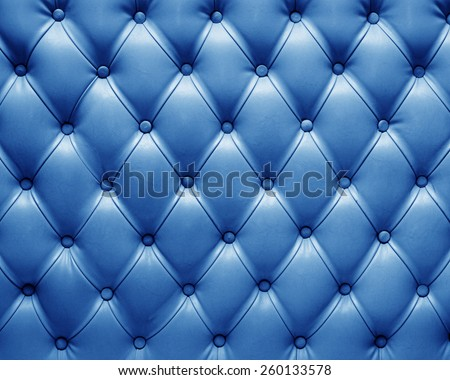 blue genuine leather chesterfield upholstery - stock photo