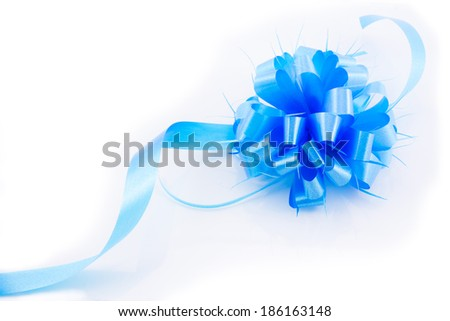 Blue gift bow ribbon isolated over the white background - stock photo