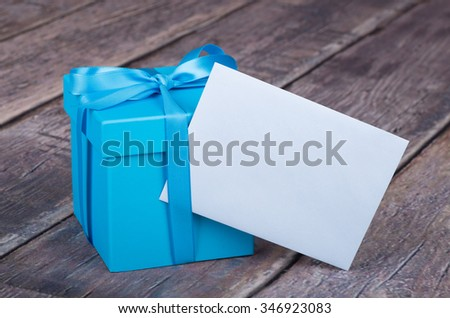 Blue gift box with blank greeting card envelope