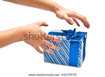 Blue gift box with bow and man's hands. Isolated on white - stock photo