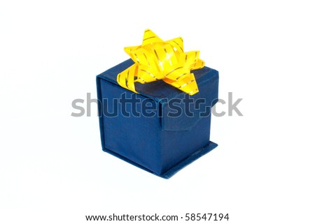 Blue gift box with yellow flower isolated on white background