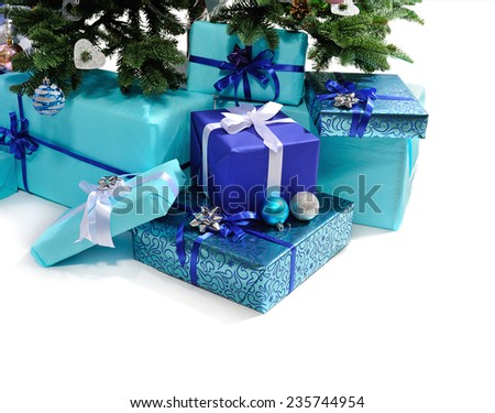 blue gift boxes under Christmas tree.isolated on white  - stock photo
