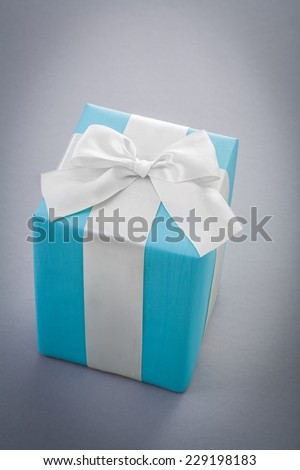 blue giftbox on gray background