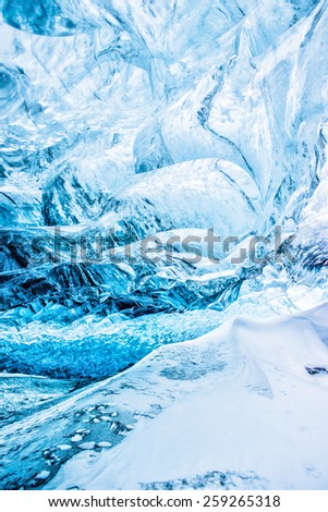 Blue glacier ice cave ba?kground in Iceland - stock photo