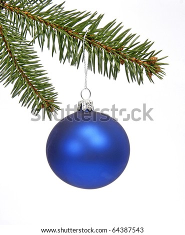 Blue glass ball hanging loosely on the twig of the spruce