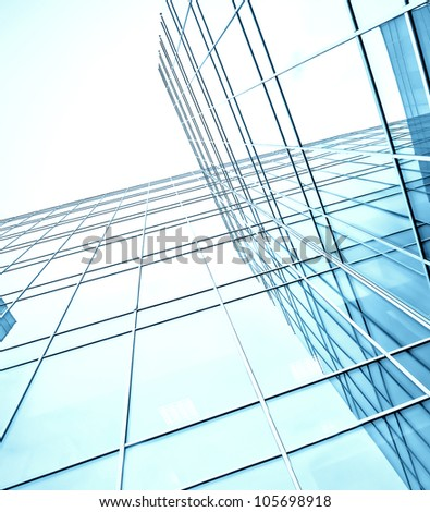 blue glass high-rise corporate building - stock photo