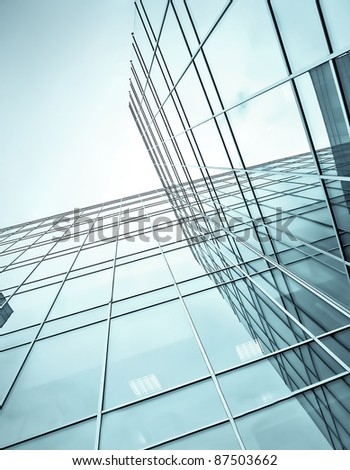 blue glass high rise corporate building - stock photo