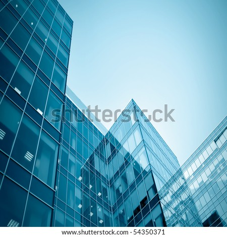 blue glass modern business center at night - stock photo