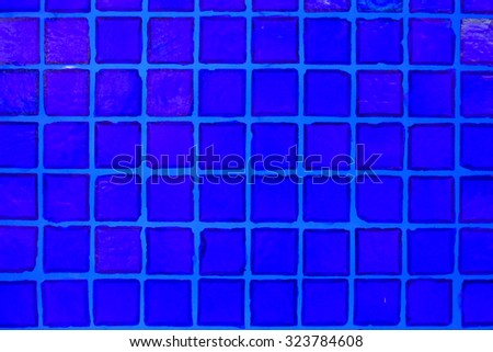 blue glass square decorating on the wall for abstract texture background