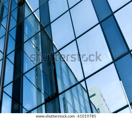 blue glass transparent wall of modern building house