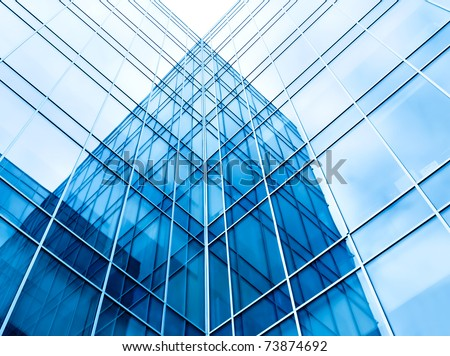 blue glass wall of office building - stock photo