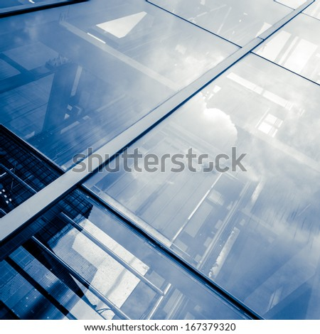 Blue glass wall with small square cells and steel frames - stock photo