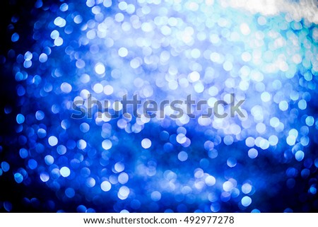 blue glitter texture christmas abstract background. Abstract blue lights on background. bokeh blue background.