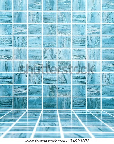 Blue glossy ornamental stone tiled wall and floor in spacious bath room - stock photo