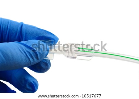 blue gloved hand putting a cap on surgical tubing - stock photo