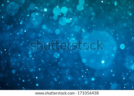 blue glowing bokeh background - stock photo