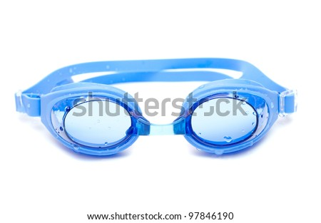 Blue goggles for swim with water drops on white background