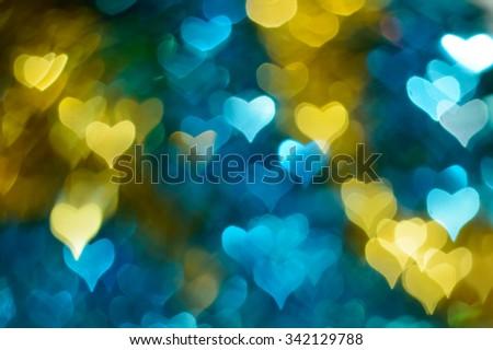 Blue gold heart shining bokeh background - stock photo