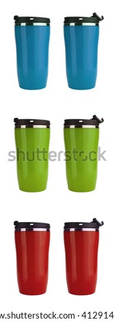 Blue, green and red thermos coffee flasks isolated on white with copy space  - stock photo