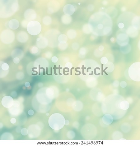 blue green background, white bokeh lights shimmering and floating in sky, spring Easter background color design - stock photo