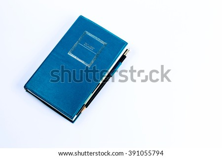 Blue green leather diary notebook with pencil isolated on white background - stock photo