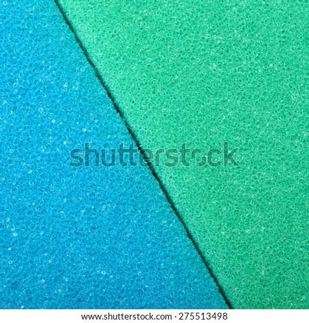 Blue green texture cellulose foam sponge background. Square format. - stock photo