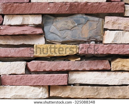 blue grey deep and light red brown color stones on stone wall surface background - stock photo
