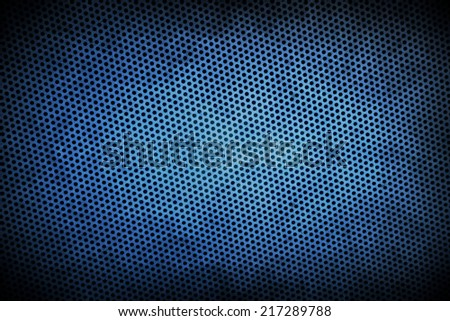 blue grunge perforated background with vignette - stock photo
