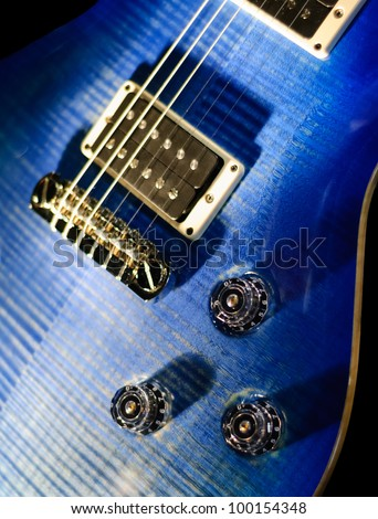 blue guitar isolated knob detail - stock photo