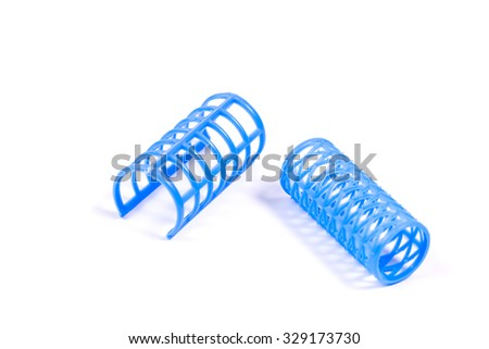 Blue hair curlers isolated on white background. - stock photo