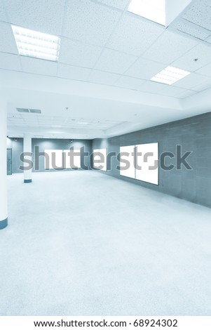 blue hall with white placards - stock photo
