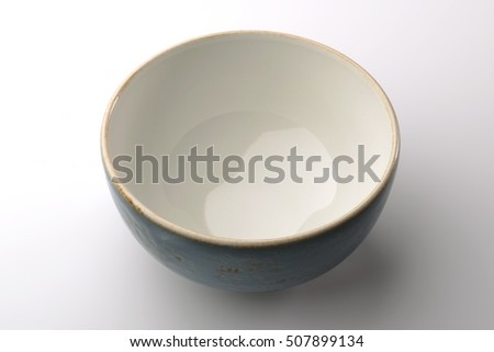 Blue hand-crafted chinese bowl isolated on white background