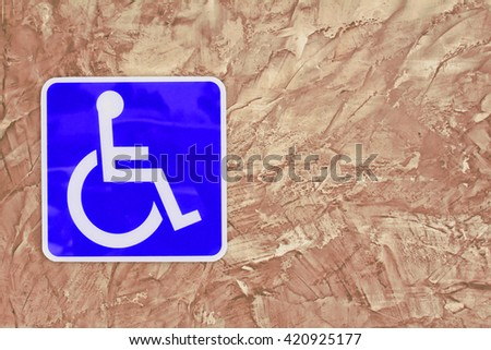 Blue handicap parking or wheelchair  on wall Cement textured background