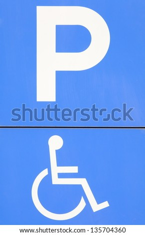 blue handicap parking or wheelchair parking space sign - stock photo