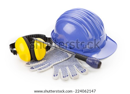 Blue hard head gloves and tools. Isolated on a white background.