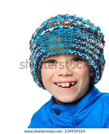 Blue hat and vest clothing boy on white background - stock photo