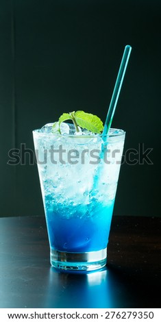 blue hawaiian soda with peppermint on top - stock photo
