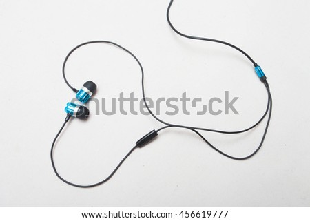 blue headphones with plug isolated on white background