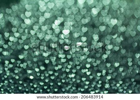 Blue heart bokeh blurred background. - stock photo