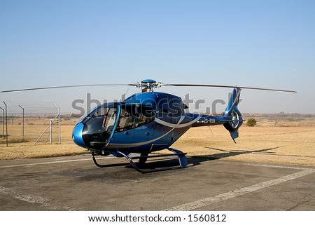 Blue helicopter - stock photo