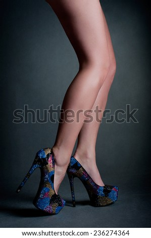 Blue high heels on beautiful female legs - stock photo
